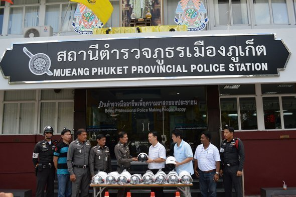 Phuket police receive donation of essential items