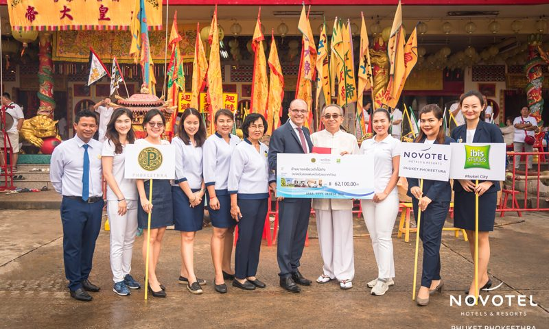 Novotel Phuket Phokeethra staffs donate money, water, rice and oil  to three local shrines in Phuket