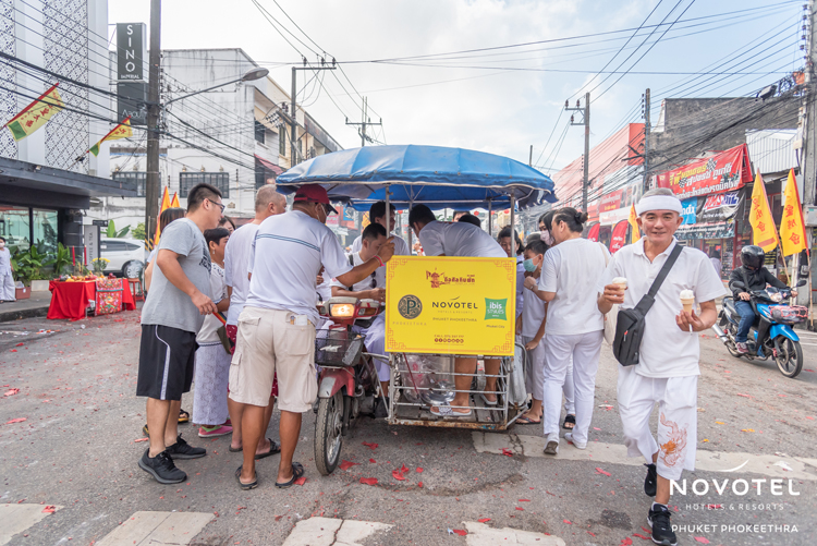 The teams at Novotel Phuket Phokeethra and ibis Styles Phuket City donated ice cream during one of the street processions involved in the annual Vegetarian Festival