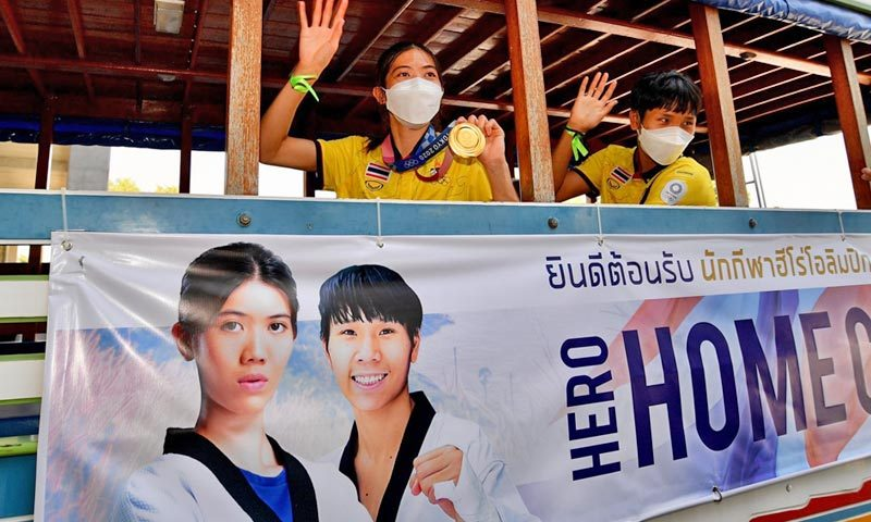 Thailand's golden girl Panipak returns to hero's welcome